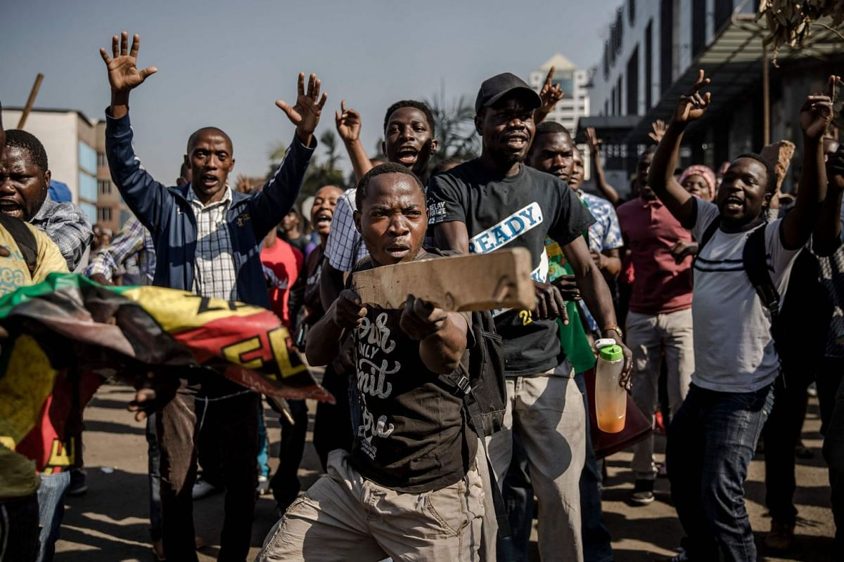Supporters of Zimbabwean opposition MDC Alliance take part in a protest in Harare on August 1, 2018, as protests erupted over alleged fraud in the country's election. PHOTO: AFP