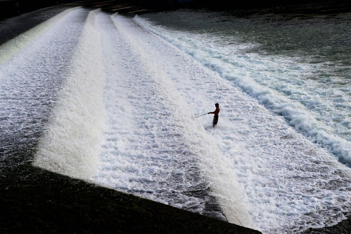 A man cools down in water on August 1, 2018 in Landsberg am Lech, Germany. PHOTO: DPA VIA AFP