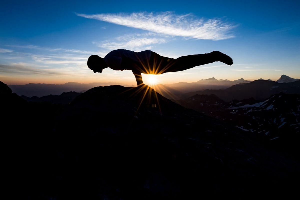 Emilien Badoux, swiss freerider and Yoga teacher practices Yoga at sunrise on the top of Mont Fort peak (3,329 meters above sea level) surrounded by Swiss Alps, between Nendaz and Verbier, Switzerland,  August 2, 2018. PHOTO: EPA-EFE