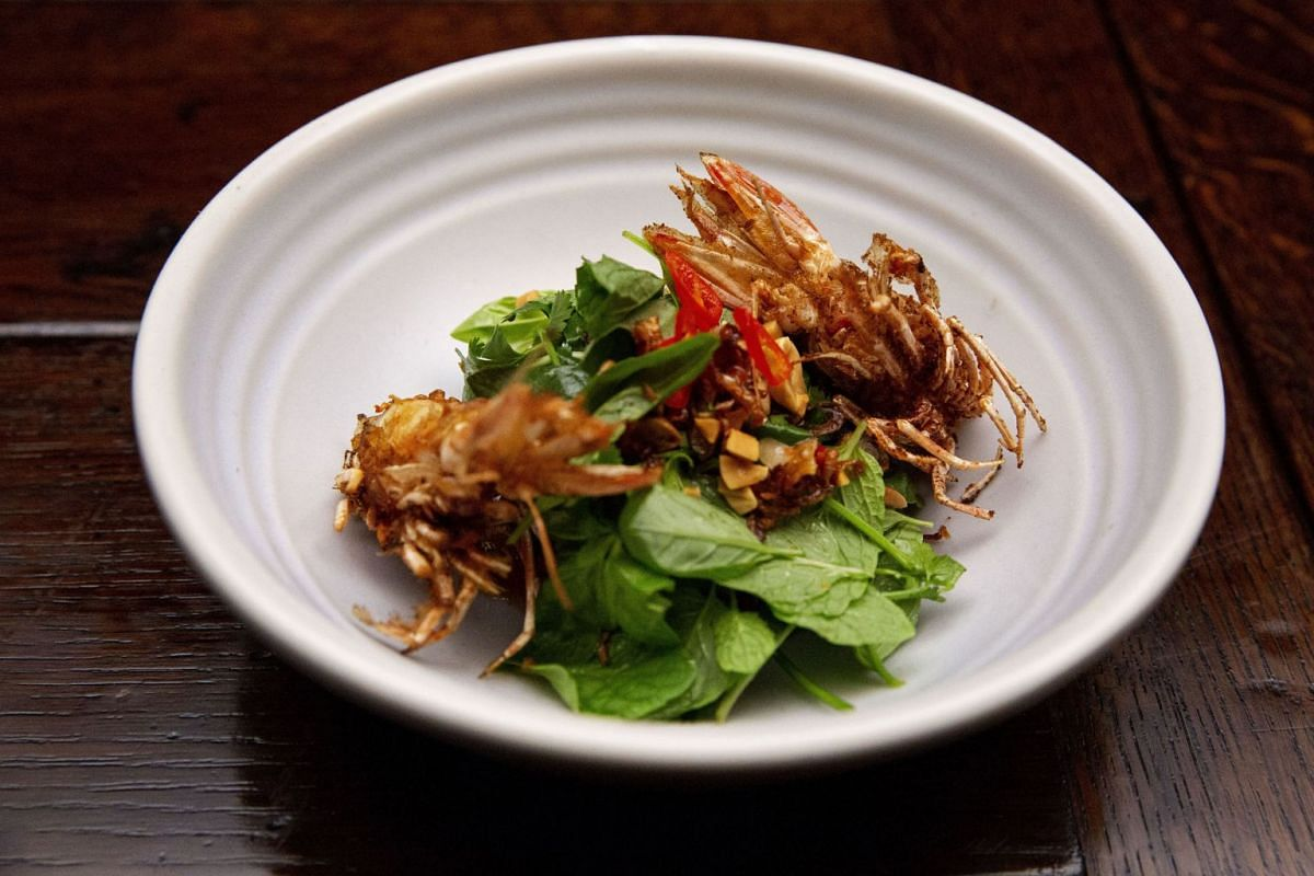 Sashi cooked this dish of sambal prawn with crispy prawn heads and herb salad in the first round of the grand finale of MasterChef Australia.