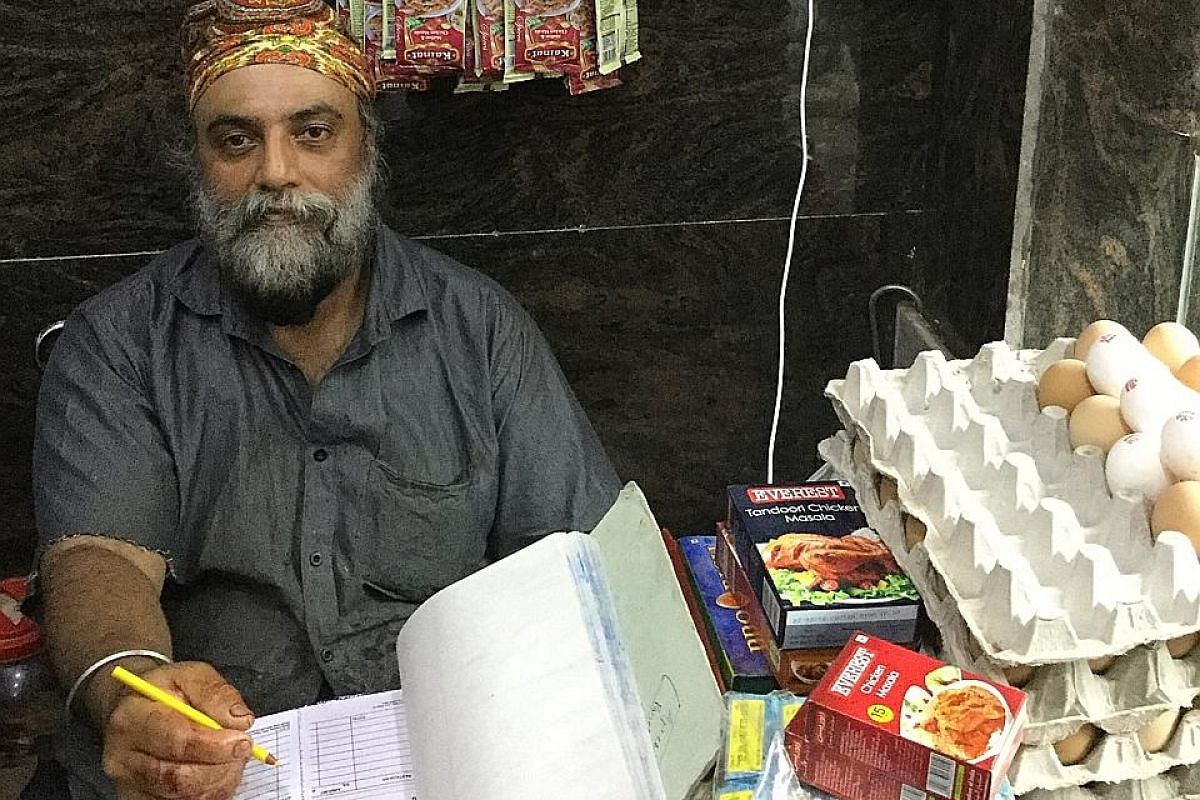 Top: Mr Ranjit Singh came to India in 1992 and applied for citizenship in 2007. He is still waiting to get it. Above: Mr Jagmohan Singh Gaba at his meat shop in Delhi's Krishna Park neighbourhood. He applied for citizenship eight years ago and has ye
