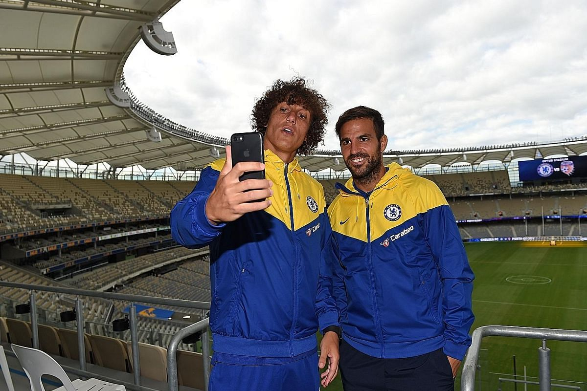 Chelsea's David Luiz (left) and Cesc Fabregas take a wefie at Perth Glory's Optus Stadium before their friendly against the A-League side on July 23. The two stalwarts of the Blues' last title-winning side in the 2016-17 season will start the campaign und