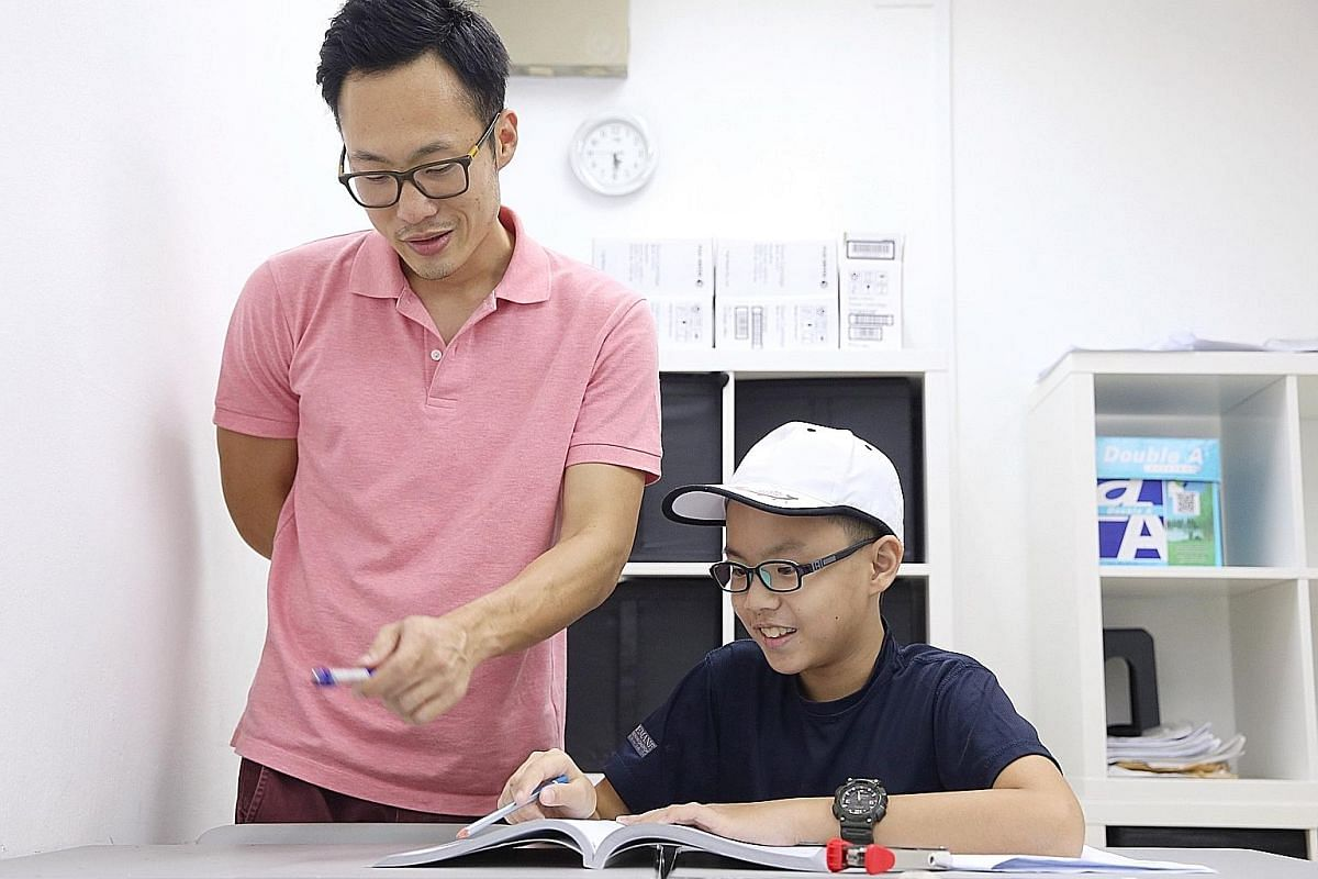 Mr Tong Hong Mun coaches Andrew Lee for maths competitions. Science tutor Ephrem Chong with former student Shachah Chua (far left) and current student Jayden Yoong (left). He uses experiments and hands-on activities to pique his students' interest.