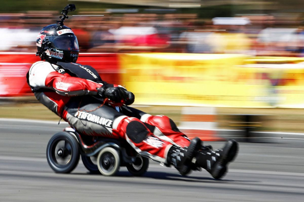 German extreme athlete Dirk Auer drives on his jet-powered Bobby car to set a new world record at 119.68 km/h during an airport racing event in Bottrop-Kirchhellen, western Germany, August 5, 2018.