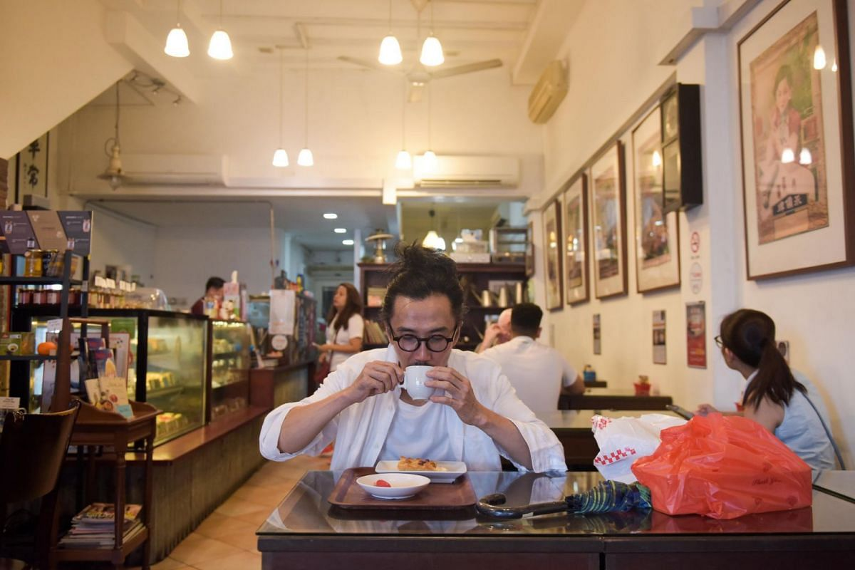 """""""I will always start or end my day here,"""" says Mr Yang while drinking his cup of tea at Dong Po Colonial Cafe. This is his usual routine whenever he visits Arab Street to buy materials for his costumes or design project."""