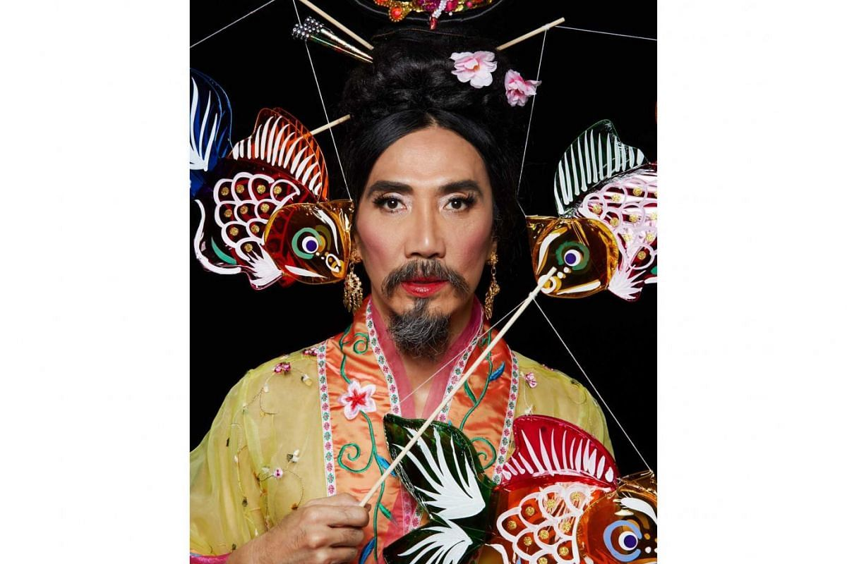 Mr Yang's various costumes include: Dressing up as Chang E to celebrate the Moon Cake Festival.