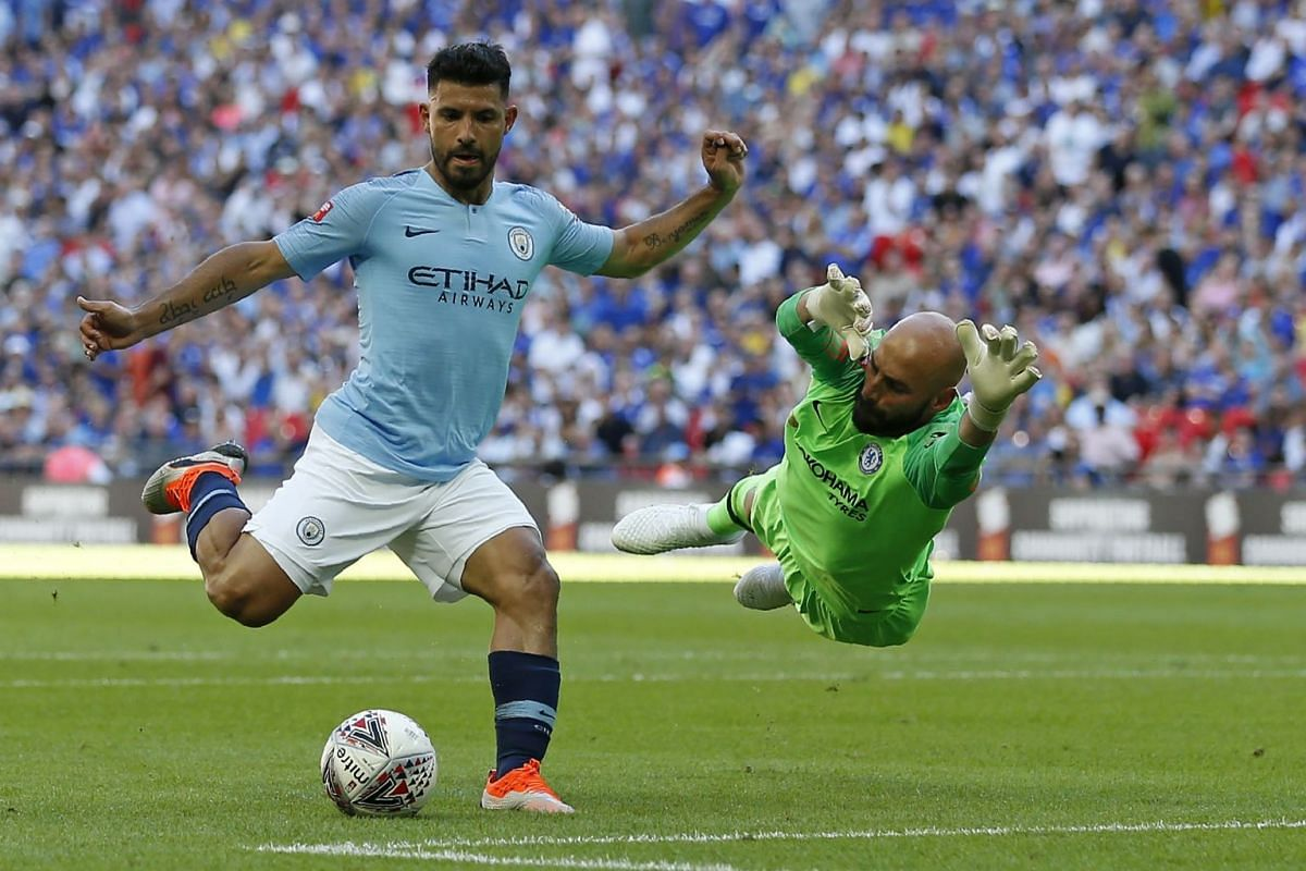 Manchester City's Argentinian striker Sergio Aguero (left) goes around Chelsea's Argentinian goalkeeper Willy Caballero but puts his shot wide during the English FA Community Shield football match between Chelsea and Manchester City at Wembley Stadiu