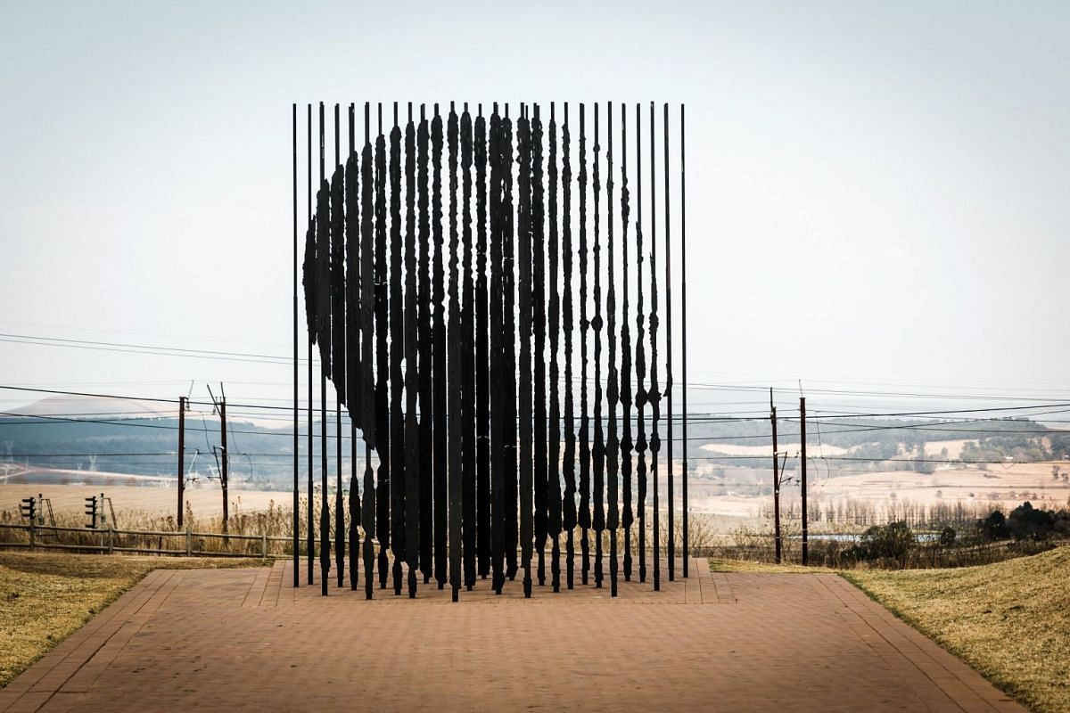 A monument made of 50 steel columns and entitled 'Release' by South African artist Marco Ciafanelli, representing the 27 years behind bars of the first black and former South African president Nelson Mandela, is seen at the Nelson Mandela Capture Si