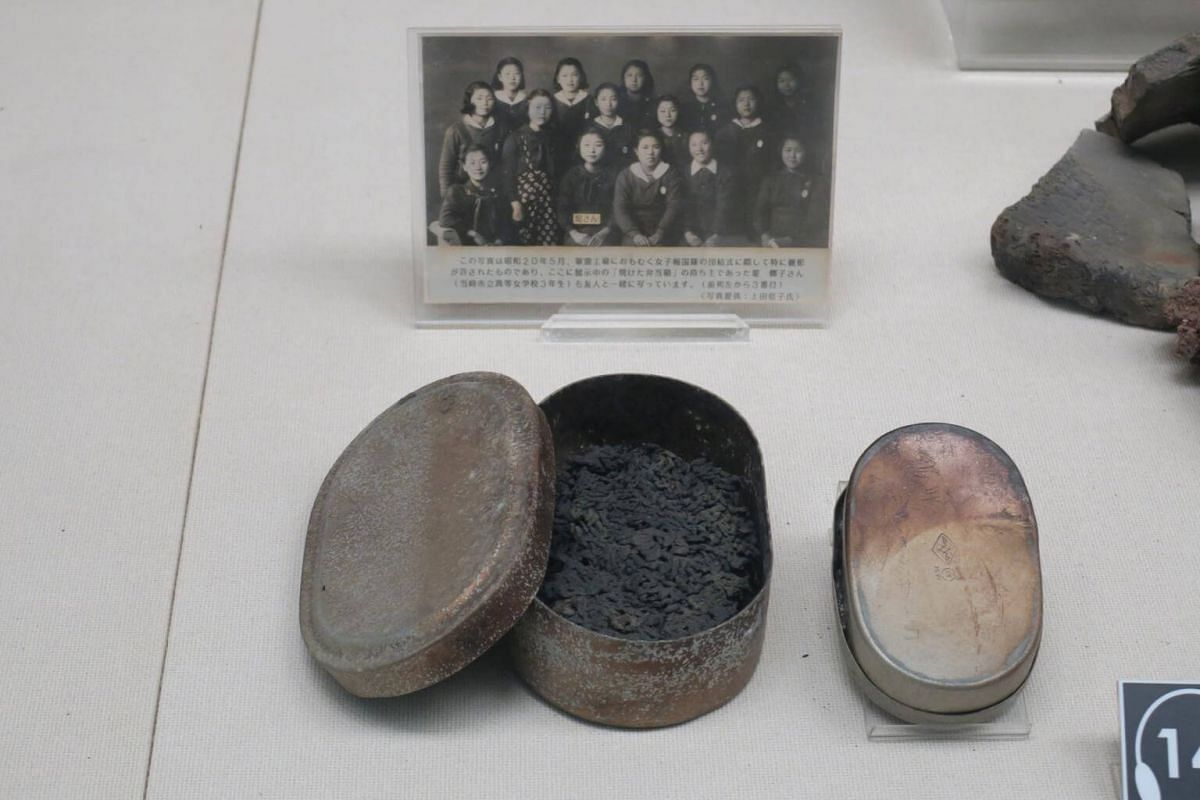 A lunch box owned by Satoko Tsutsumi, who was 14 at the time of the atomic bombing, is displayed at the Nagasaki Atomic Bomb Museum.