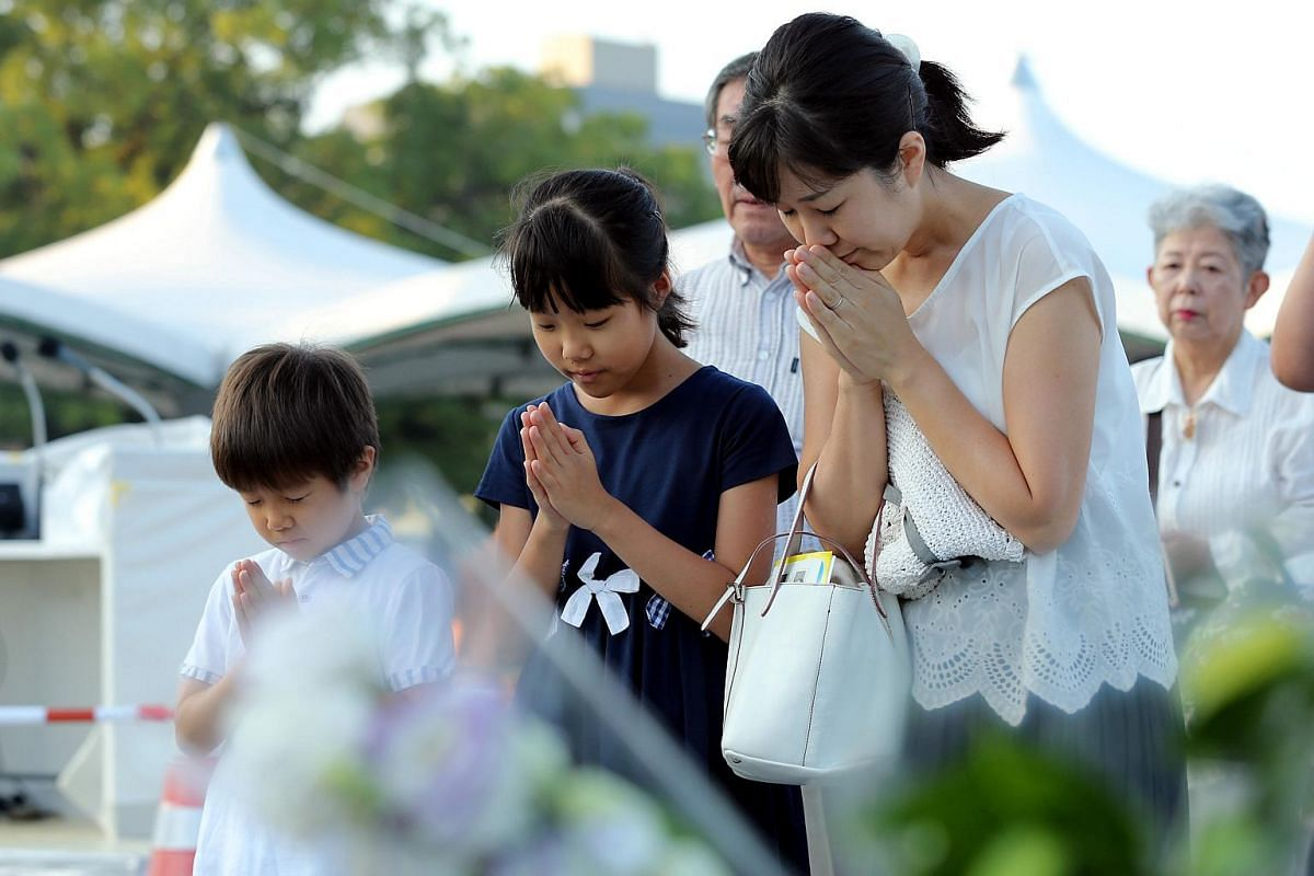Residents offering prayers for victims of the 1945 atomic bombing at Hiroshima Peace Memorial Park, on Aug 6, 2018.