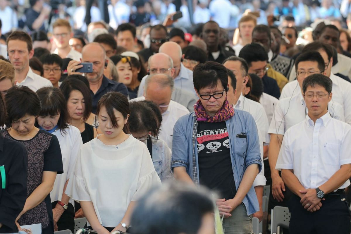 People offering a minute of silent prayers for victims of the 1945 atomic bombing at the Hiroshima Peace Memorial Park, on Aug 6, 2018.