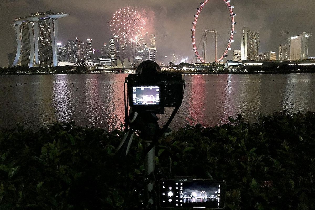 The writer's set-up of a mirrorless camera and a smartphone to capture the National Day Parade fireworks at Gardens by the Bay East.