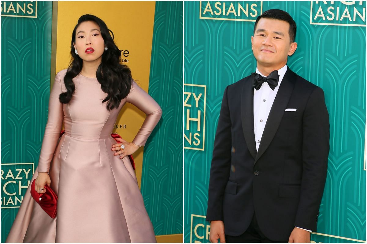 Rapper Awkwafina (left) and actor Ronny Chieng attend the premiere of Crazy Rich Asians in Hollywood, California, on Aug 7, 2018.