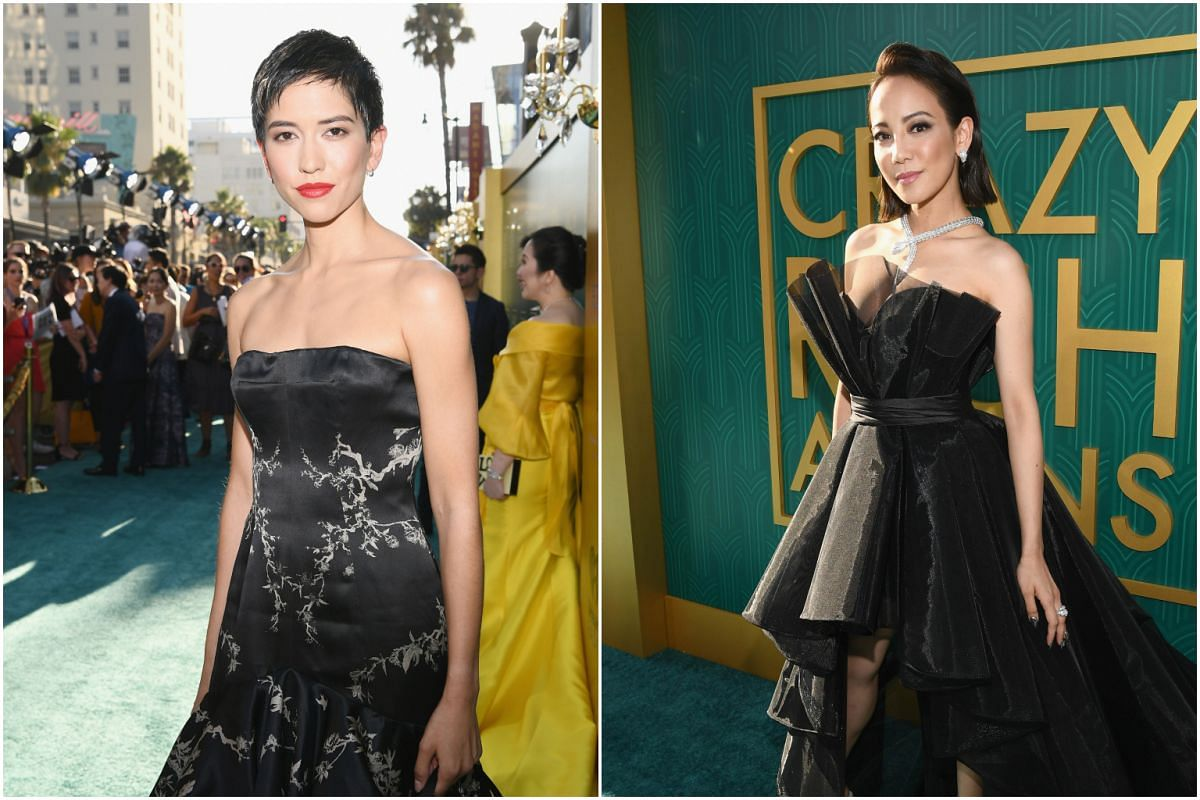 Actresses Sonoya Mizuno (left) and Fiona Xie arrive at the Crazy Rich Asians premiere at TCL Chinese Theatre IMAX in Hollywood, California on Aug 7, 2018.