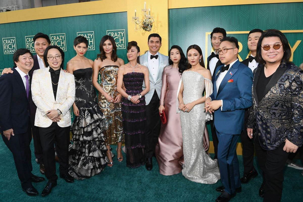 The cast of Crazy Rich Asians (from left) Ken Jeong, Jon M. Chu, Jimmy O. Yang, Sonoya Mizuno, Gemma Chan, Michelle Yeoh, Henry Golding, Awkwafina, Constance Wu, Chris Pang, Nico Santos, Ronny Chieng, and author Kevin Kawn at the Crazy Rich Asians pr