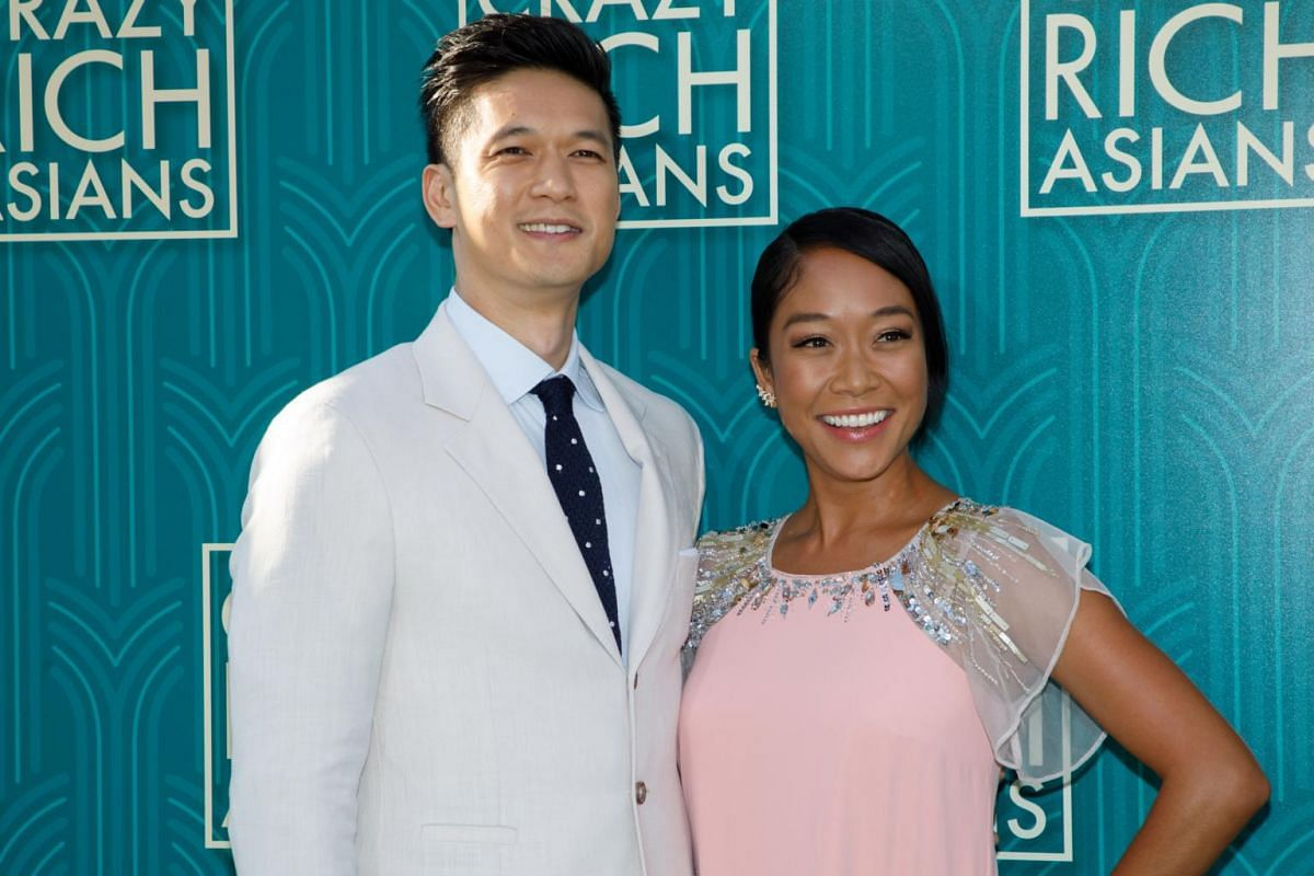 Cast member Harry Shum Jr (left) and wife, actress Shelby Rabara attend the US premiere of Crazy Rich Asians at the TCL Chinese Theatre IMAX in Hollywood on Aug 7, 2018.