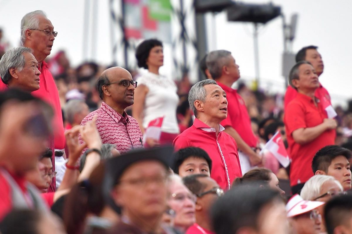 Cabinet members and MPs sing the national anthem during the National Day Parade on Aug 9, 2018.