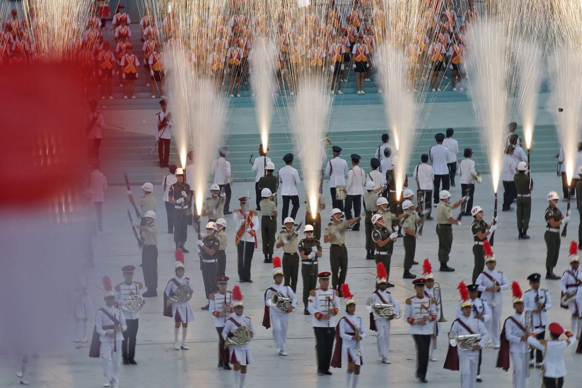 Members of the Singapore Armed Forces' precision drill team and the military band performing during the National Day Parade on Aug 9, 2018.