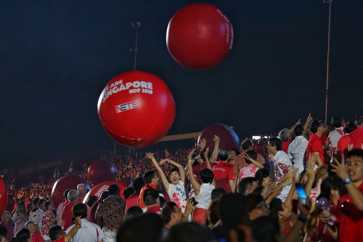 Cabinet ministers and MPs play with giant balls released during the National Day Parade on Aug 9, 2018.