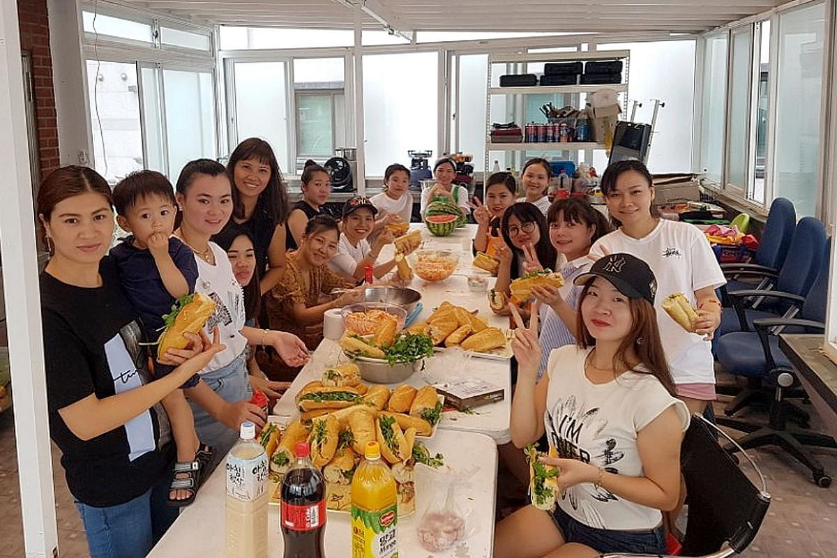 Vietnamese migrant wives at a gathering to bond and enjoy hometown food together. South Korea has more than 200 multicultural family support centres.