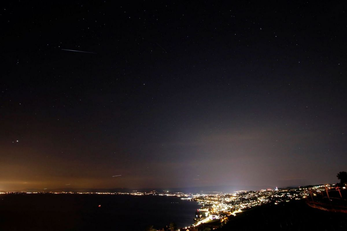 A meteor streaks past stars in the night sky in Grandvaux, Switzerland, during the Perseid meteor shower on Aug 10, 2018.