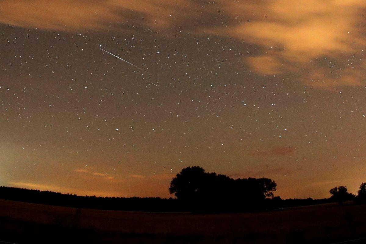 A meteor streaks past stars in the night sky during the Perseid meteor shower in Premnitz, Germany, on Aug 11, 2018.