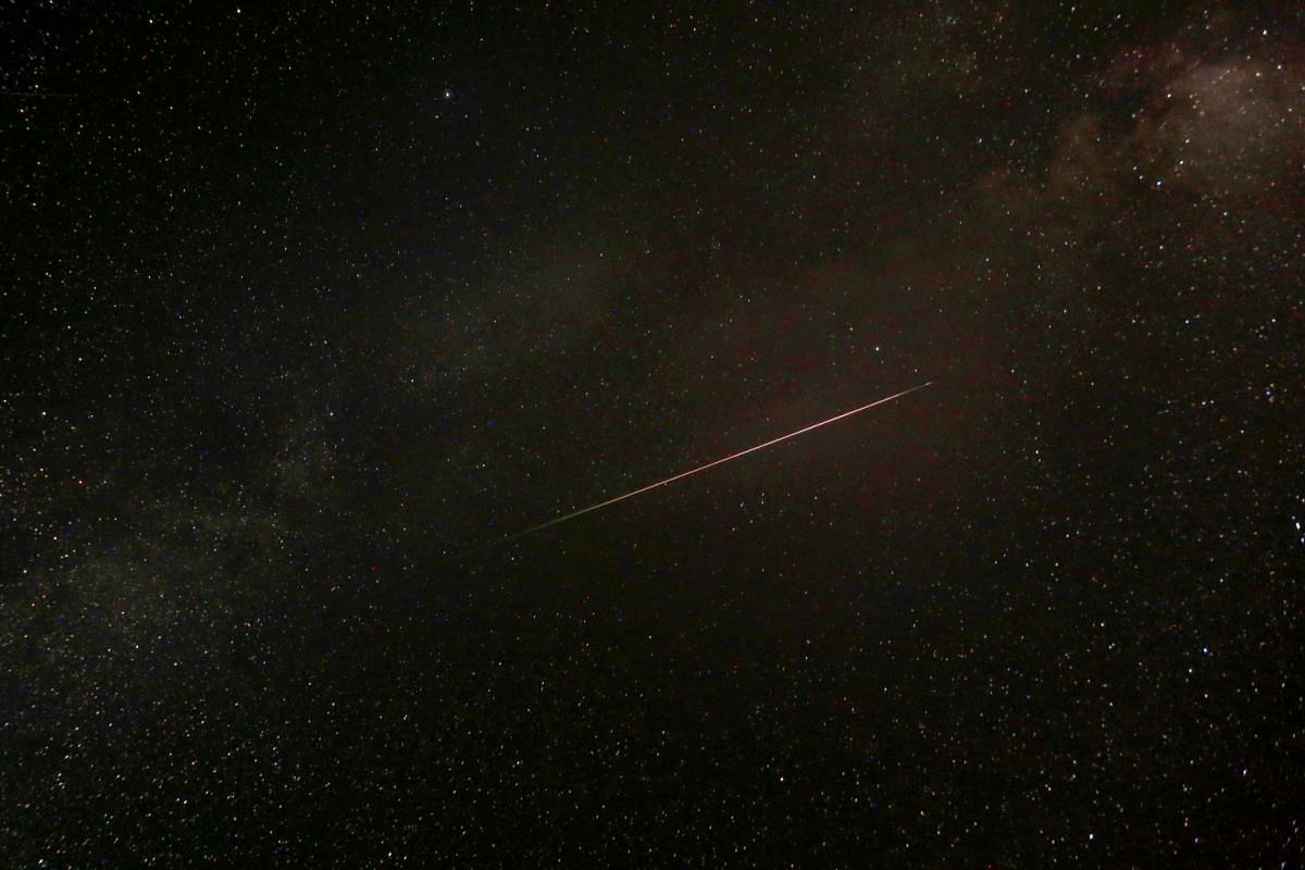 A meteor streaks past stars in the night sky during the peak of the Perseid meteor shower at Mavrovo national park in Macedonia Aug 12, 2018.