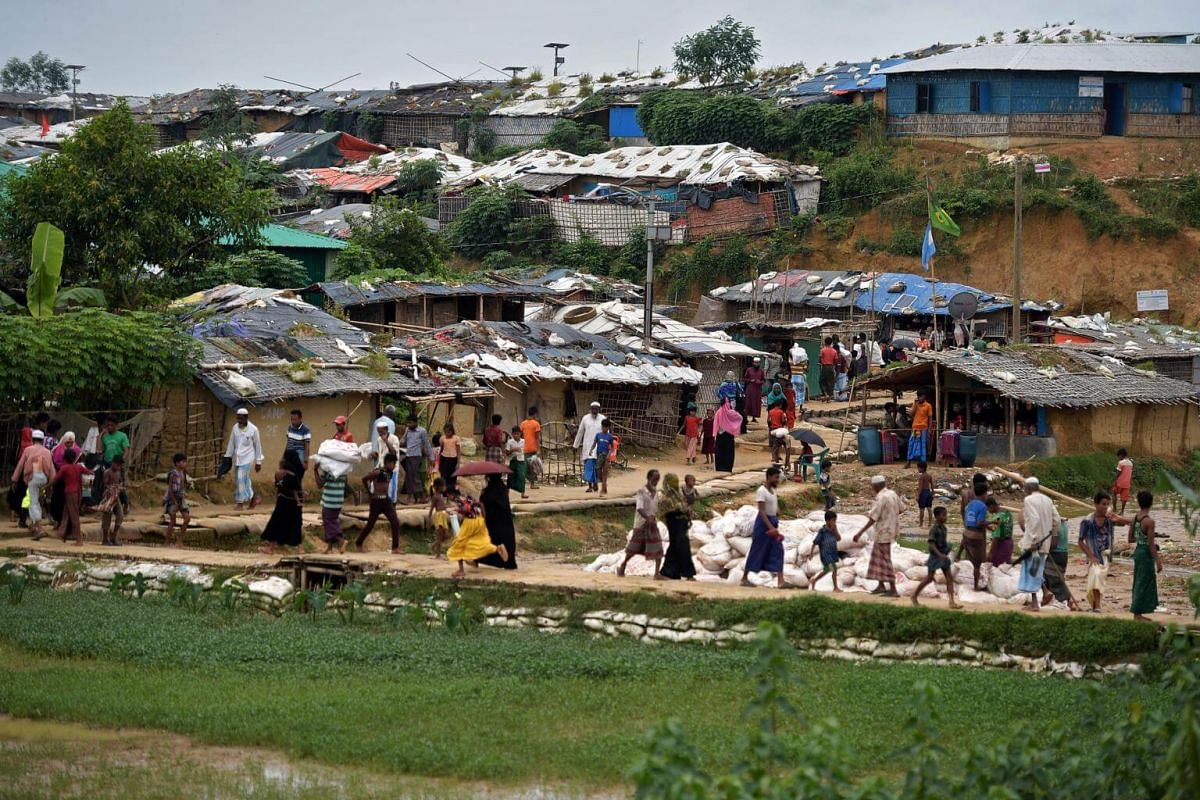 Rohingya refugees going about their daily lives at the Kutupalong megacamp, in Bangladesh's Cox's Bazar district, where about 626,000 people are squeezed into an 12 sq km area.