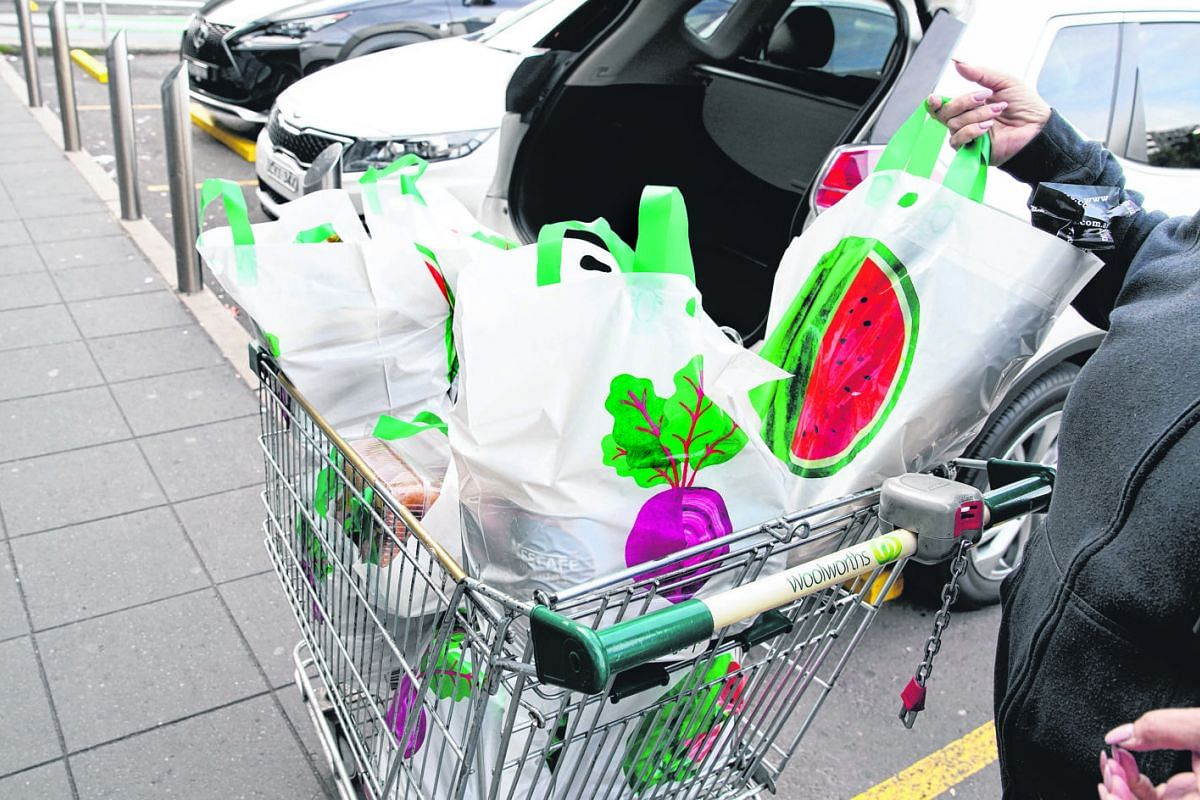 A shopper unloading reusable plastic bags provided by supermarket chain Woolworths in Sydney last month. The chain's ban on single-use bags prompted anger among consumers, who claimed to be unprepared.