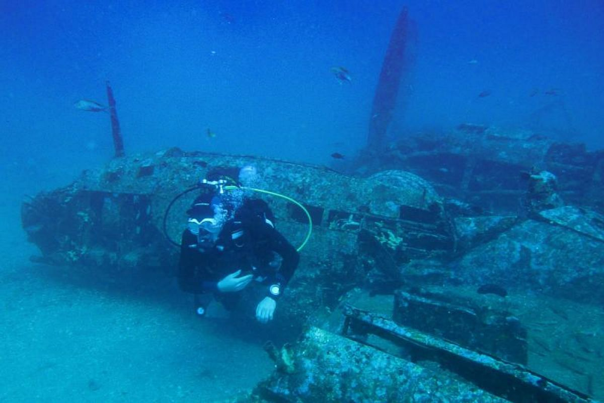 A diver explores the wreckage of an American bombardier fighter plane, a Lockheed P-38G Lightning from the Second World War, at 38 meters of depth, on Aug 12, off the coast of La Ciotat, southern France. PHOTO:AFP