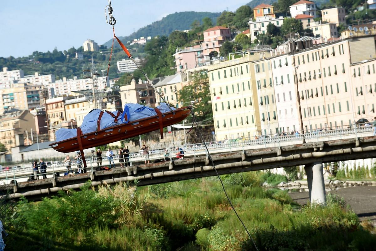 Rescue workers recover a body at the site of the collapsed Morandi Bridge in the port city of Genoa, Italy on Aug 14, 2018.