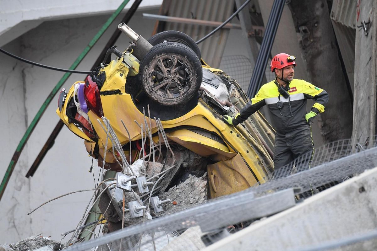 Rescuers at work after the bridge collapsed in Genoa, Italy, on Aug 14, 2018.