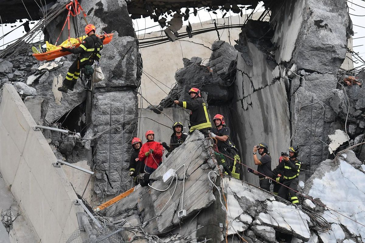 Rescuers at work to recover an injured person after the bridge collapsed, on Aug 14,2018.