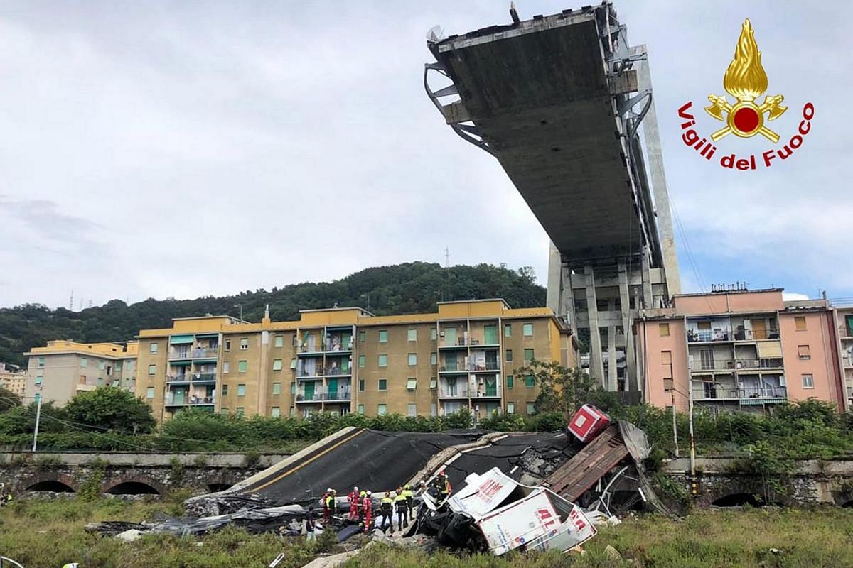 A handout photo made available by Italian firefighters shows rescue teams on the site of a collapsed bridge over the A10 highway in Genoa, Italy, on Aug 14, 2018.