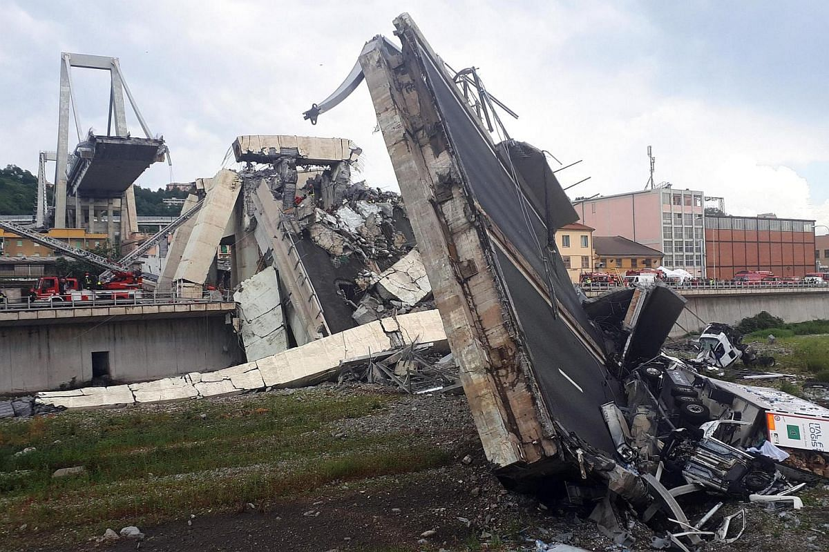 Rescuers at work amid the rubble after the bridge collapsed, on Aug 14, 2018.