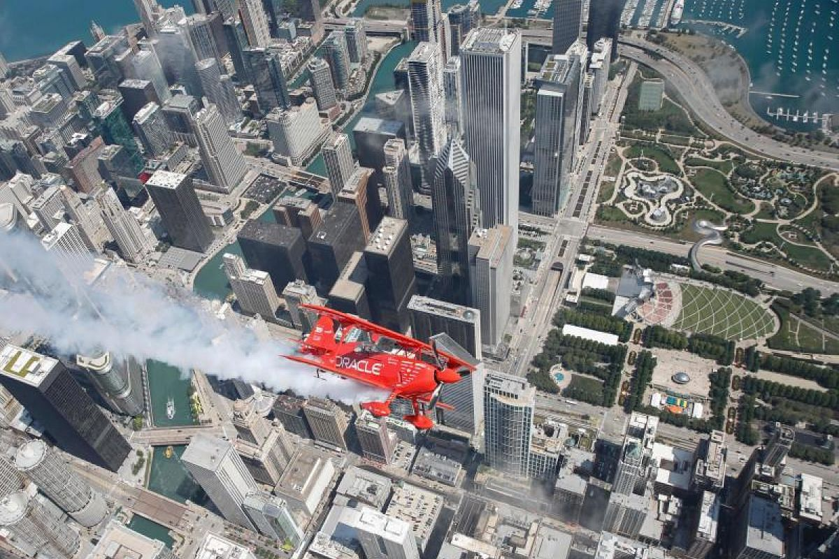 Hall of Fame Air Show Performer Sean D. Tucker flies his Oracle Challenger III aircraft over downtown Chicago as he prepares for the 60th annual Chicago Air and Water Show on Aug 16, 2018 in Chicago, Illinois. PHOTO:AFP