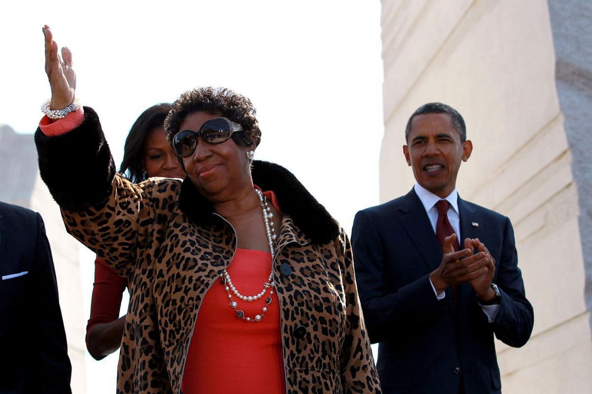Aretha Franklin is joined by former President Barack Obama and wife Michelle Obama at the dedication of the Martin Luther King Jr. Memorial in Washington, on Oct 16, 2011.