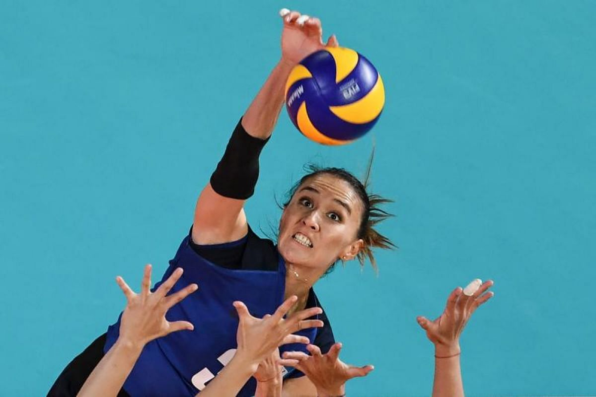 Kazakhstan's Sana Anarkulova hits the ball during their women's Group B preliminary volleyball match between Taiwan and Kazakhstan at the 2018 Asian Games in Jakarta on Aug 19, 2018.  PHOTO:AFP