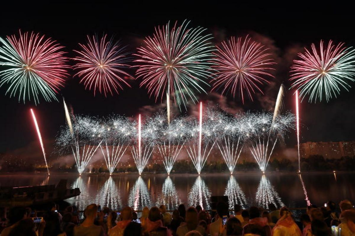 Spectators viewing fireworks during the International Fireworks Festival ROSTEC at the Brateevsky park in Moscow, Russia on 19 Aug, 2018. The 8 world teams prepare pyrotechnic shows in accordance with the contest task and compete with each other. PHO