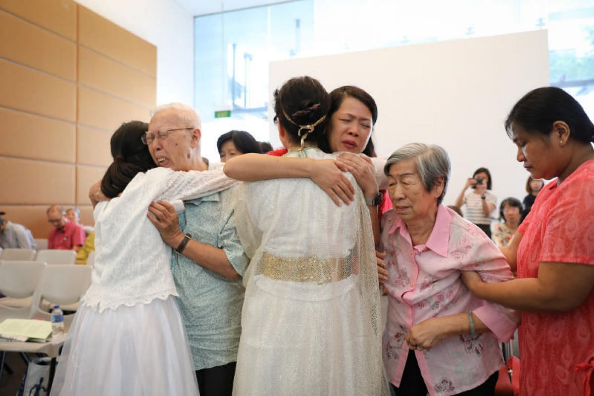 Three ladies from Japan are here to reconcile and apologise to survivors of the Japanese occupation and their immediate families. Canon James Wong (man on left), 79, retired Anglican pastor, is embraced by Tomoko Hasegawa, 58, during the reconciliati