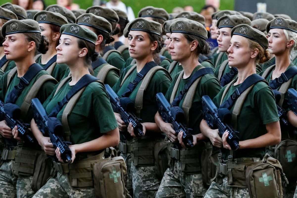 Servicewomen march during a rehearsal for the Independence Day military parade in central Kiev, Ukraine on Aug 20, 2018. PHOTO:REUTERS