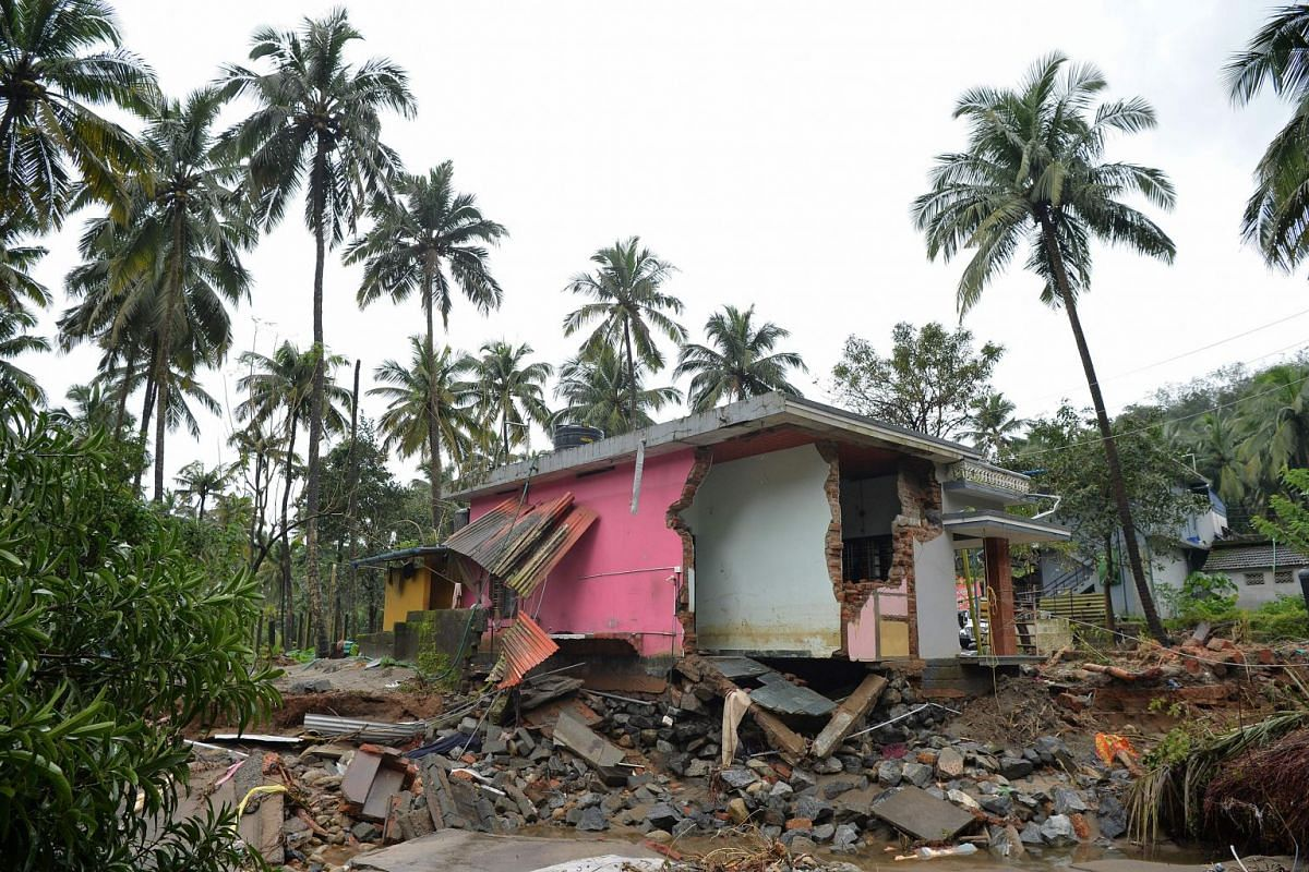 A house destroyed by a landslide in Kannapanakundu village, about 422km north of Trivandrum, in Kerala, last Saturday. Pressure intensified to save thousands still trapped by the devastating floods that triggered landslides and sent torrents sweeping