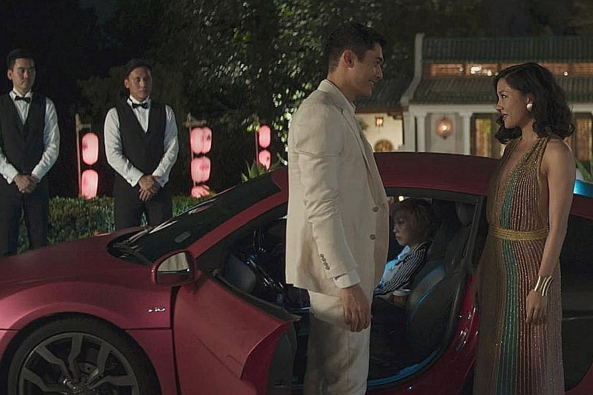 In Crazy Rich Asians, economics professor Rachel Chu (Constance Wu, right) discovers that her boyfriend, Nick Young (Henry Golding), belongs to one of Singapore's wealthiest families during a visit to the country.