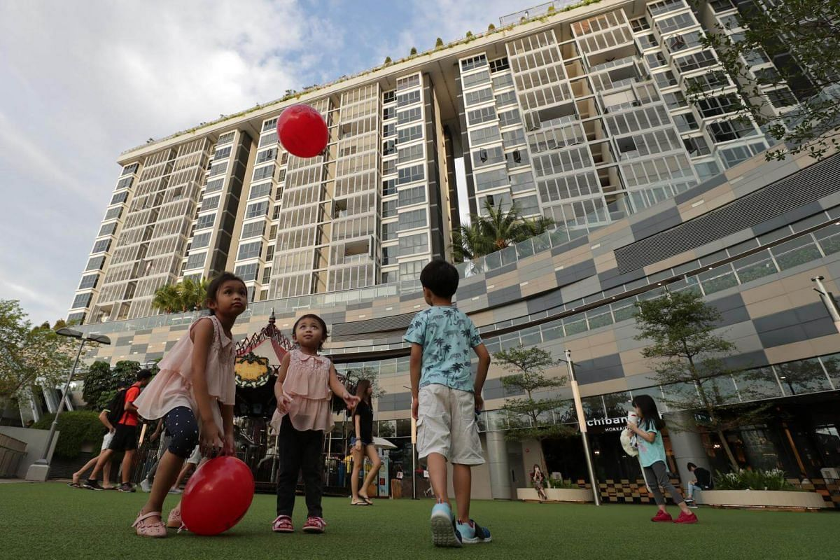 Sisters Norlydia Rizqa (left, in pink), 5, and Norwana Hawa (centre, in pink), 3, play with balloons at The Plaza @ Waterway Point.