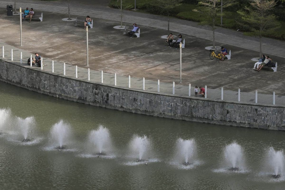 Members of the public seen next to fountains outside Waterway Point along the Punggol Waterway, on Aug 24, 2018.