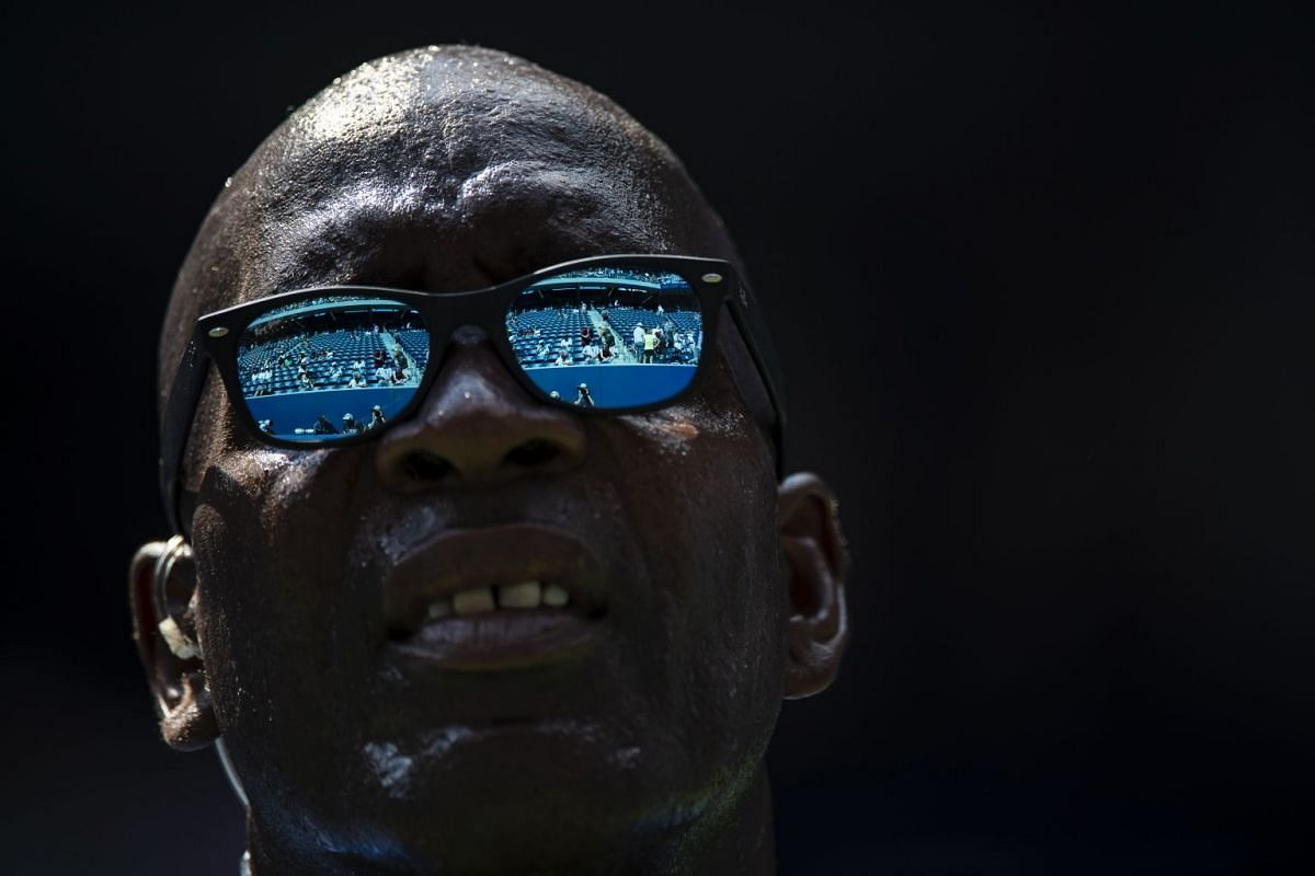 A security guard sweats as he watches from the court between games during the second round match between Venus Williams of the US and Camila Giorgi of Italy at Louis Armstrong Stadium during the US Open tennis tournament in New York, on Aug 29, 2018.