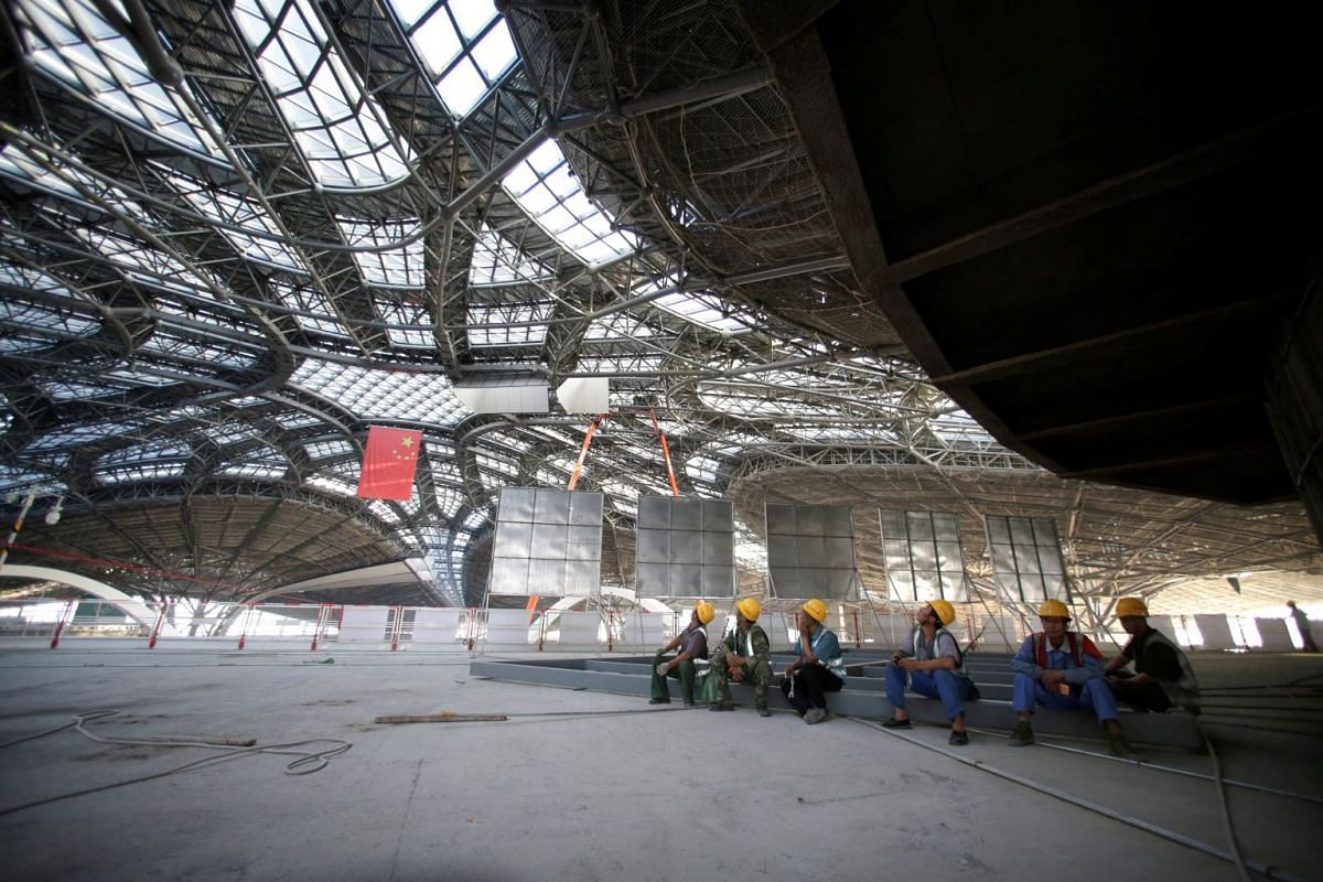 Workers rest at the terminal hall of the new Daxing International Airport under construction during a government-organised media tour on the outskirts of Beijing, China, Aug 30, 2018.