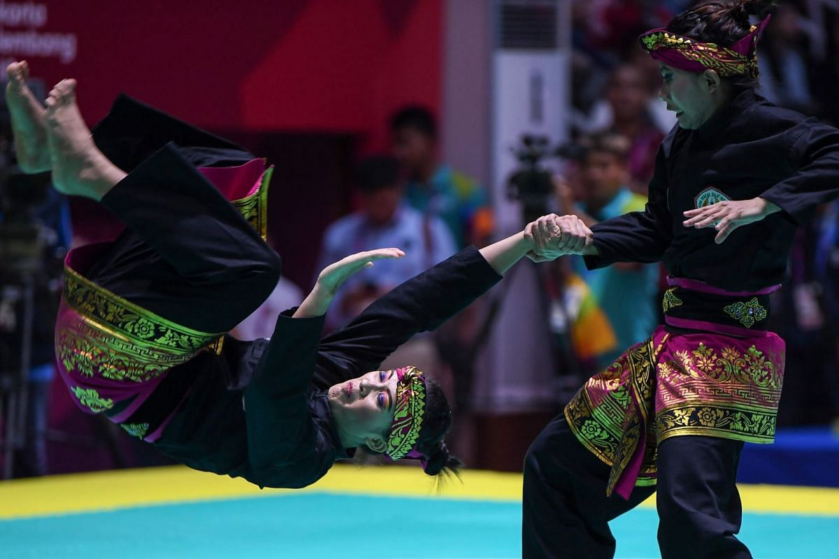 Indonesia's Ni Made Dwiyanti and Ayu Sidan Wilantari compete during the pencak silat women's double finals at the 2018 Asian Games at Jakarta on Aug 29, 2018.