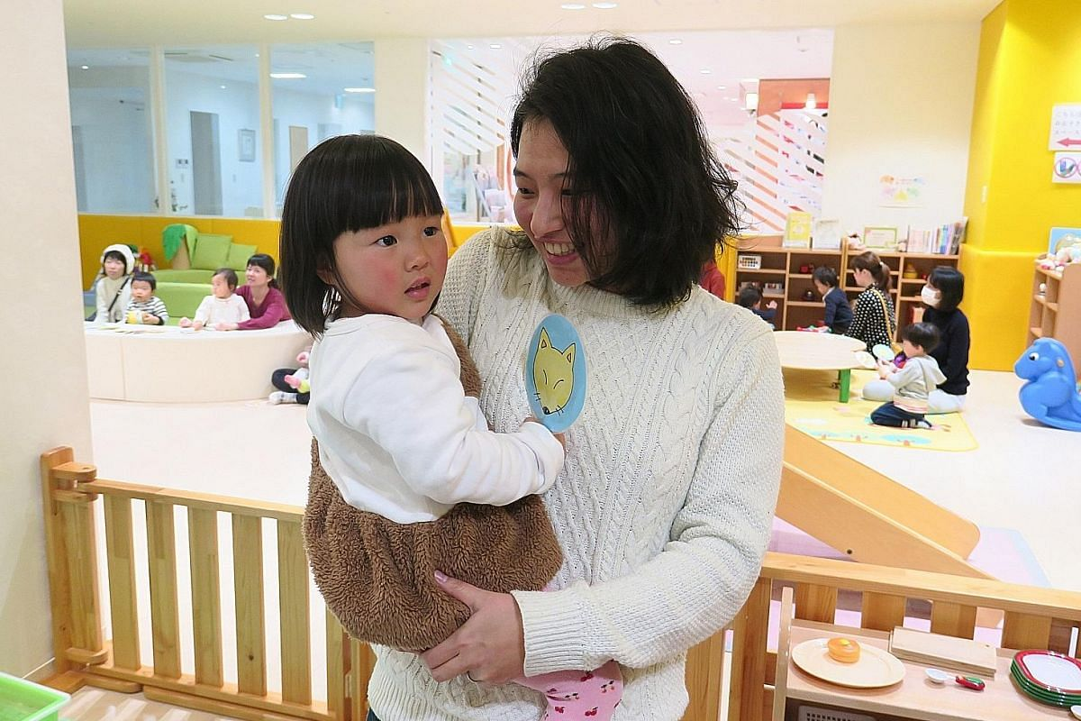 Above: Mrs Sanae Nakamura, with her younger daughter Satsuki, believes Toyama City is at the forefront of measures aimed at giving new mothers peace of mind in raising their young children. Left: The city's elderly folk use a prototype walking aid/sh