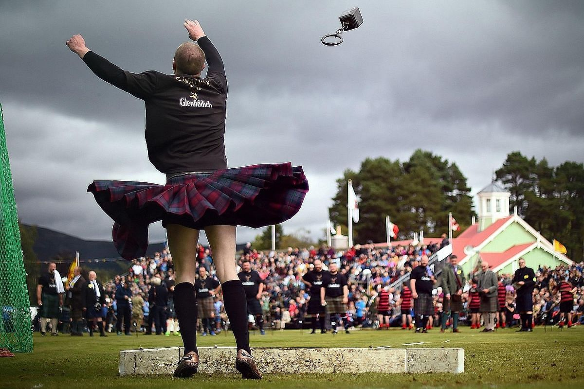 A competitor takes part in the hammer throw event at the annual Braemar Gathering in Braemar, central Scotland, on Sept 1, 2018.